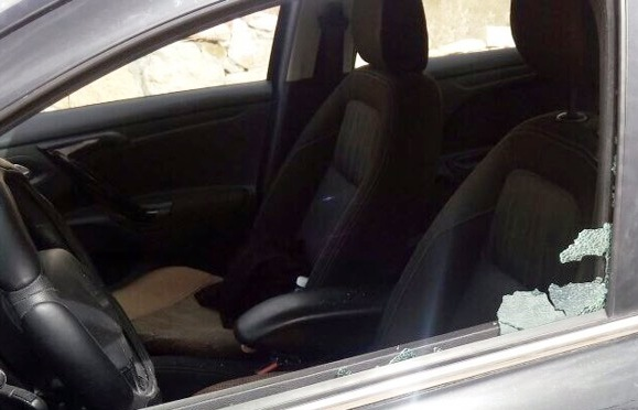 "Another Israeli narrowly escaped death when a ""rock"" was thrown through the window."
