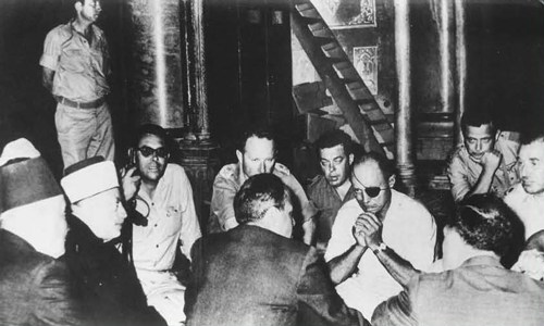 The infamous photograph of Dayan's meeting with the Jordanian Wakf during which he basically gave away the Temple Mount.