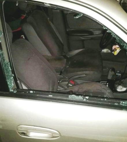 "A ""rock"" thrown by a terrorist smashed through the window of the car hitting the driver causing her to lose control of the car. Both the mother and daughter sustained numerous cuts from glass shards."