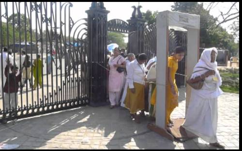 Hindu worshipers going through a metal detector at the famed Lotus Temple.