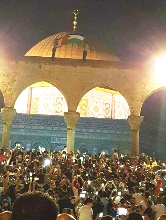 "The scene last night on the Temple Mount as thousands of Muslims thronged the area raising Palestinian flags and chanting ""Death to Israel."""