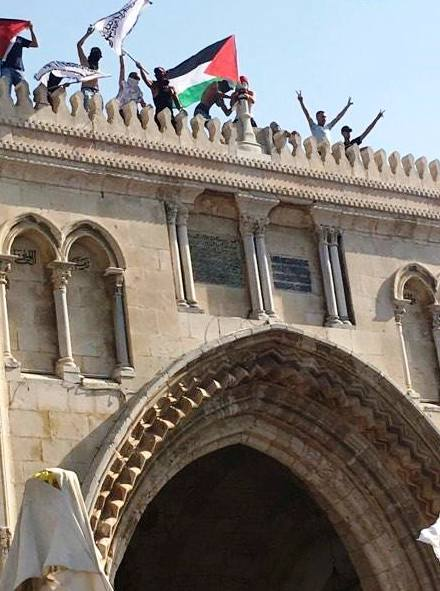 The Palestinian flag flying from atop the Old City Wall beside the Temple Mount.