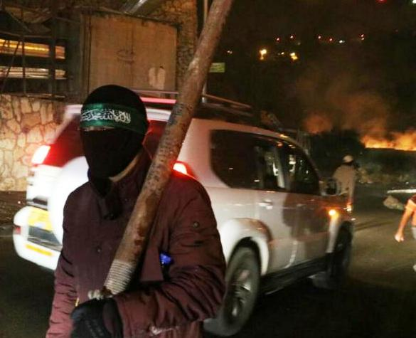 Masked terrorists rioted throughout eastern Jerusalem last night. Note the fire in the background.