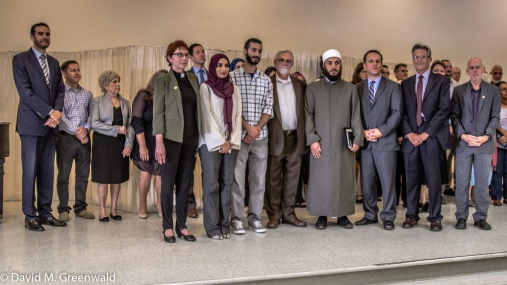"Shahin posing for photos after his ""apology"" with some of the local interfaith community (photo Greenwald: Vanguard).."