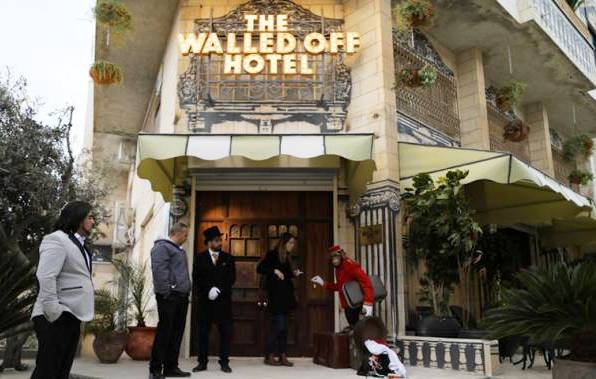 The Walled Off Hotel, catering to high-end leftists from all over the world.