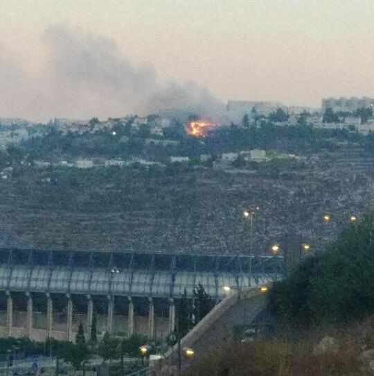 Thefire in Gilo. That's Teddy Kollek Stadium in the foreground.