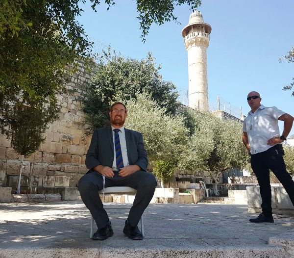 Knesset Member and Temple Mount Activist Yehuda Glick with his security guard yesterday.