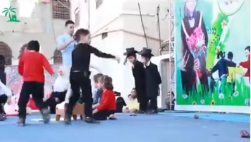 Note the wonderful costumes of the Jews and the proud parent taking pictures in the background as the kids throw things at the Jews.