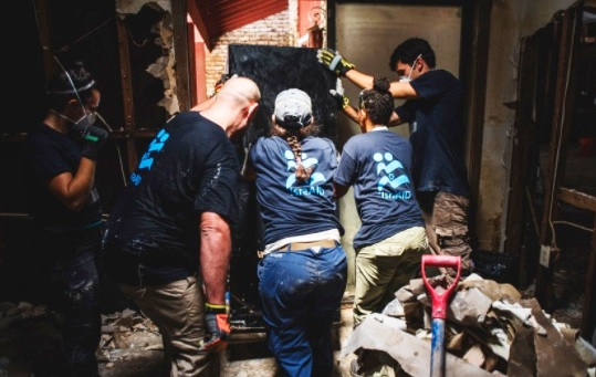 IsraAid workers clearing rubble in Texas.