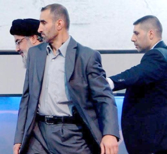 The bodyguard who was assassinated is the one directly to the side of Nasrallah in the gray suit. Note Nasrallah hunched over in the background. He only comes out of his hole in Beirut on rare occasions.