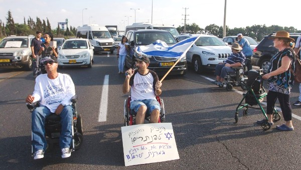 "A small group of ""disabled"" blocking a highway near Tel Aviv (picture: Times of Israel)."