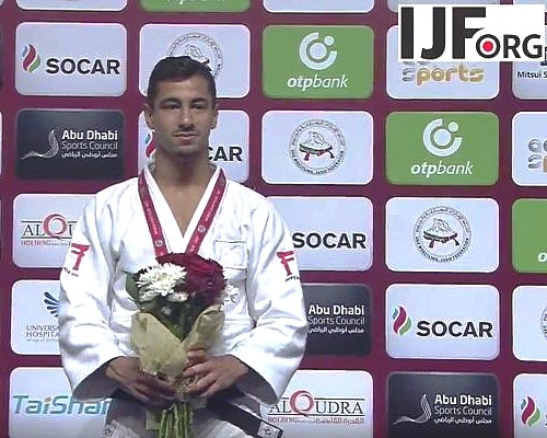 Tal Flicker on the podium receiving the gold medal. Notice the empty rectangle over his heart where the Israeli flag should have been.