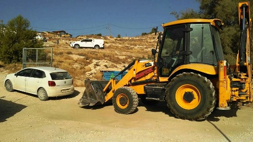 A tractor heading to the top of the hill to destroy a Jewish home in Neve Erez.