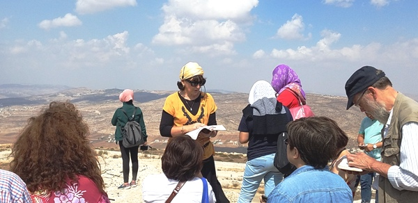 Sondra Baras, reading from the Torah at the 3 Seas overlook just outside of Itamar.