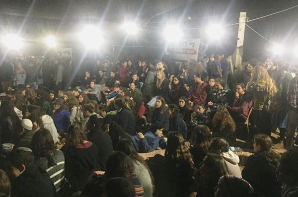 Some of the 1000 brave young people huddling together in the cold weather in Nativ Haavot last night.