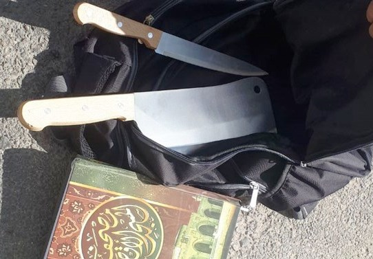 Tools of a Palestinian terrorist's trade: a Koran, a kitchen knife, and a cleaver.