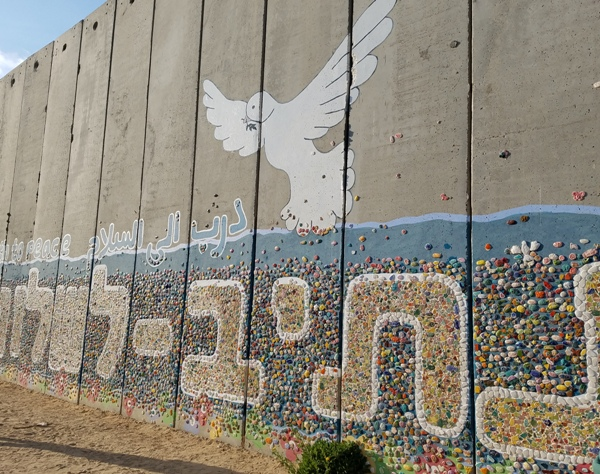 """Residents of Netiv HaAsara, like all Israelis, earnestly seek peace--and the sign reads """"The Path To Peace."""" It is unfortunate that the wall is all that keeps the peace."""
