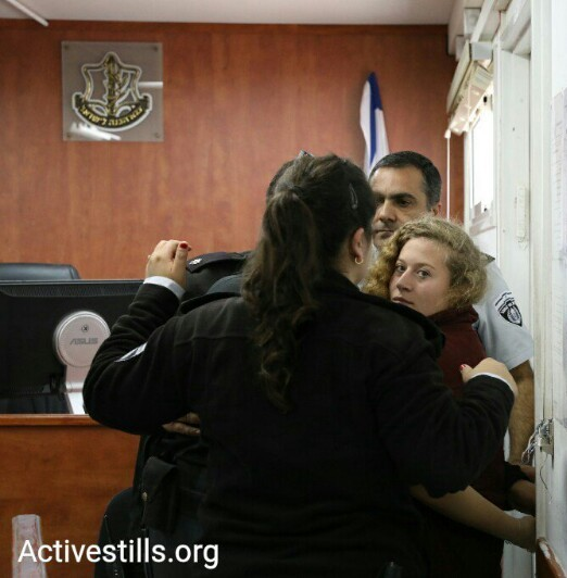 A happy Tamimi being taken to court.