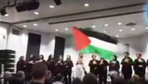 """The scene at Tel Aviv University the other day as a new """"Palestinian"""" club sang the Palestinian national anthem and waved the Palestinian flag (with apologies for the blurry picture)."""