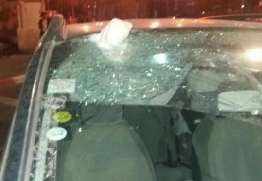 """One of the cars hit on Road 375 last night. Note that a """"rock"""" is still in the windshield (photo: Yossi Shwartz)."""