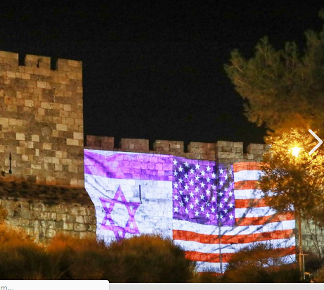 American flags were everywhere last night from this projection on part of the Old City Wall to Safra Square where Israelis were dancing in the street (photo: Jerusalem Municipality).