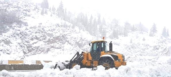 A snow plow stuck in the heavy snow near Mt. Hermon this morning. Heavy snow in the north and heavy rain elsewhere has hit Israel.