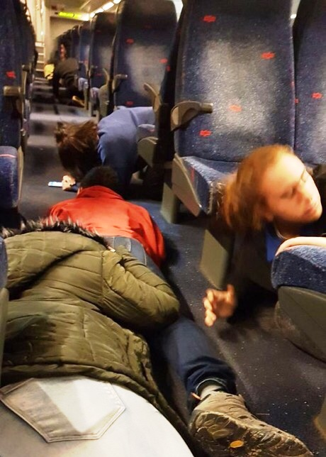 Note everyone diving for the aisle--which is what you are told to do if you are on a train that is being targeted.