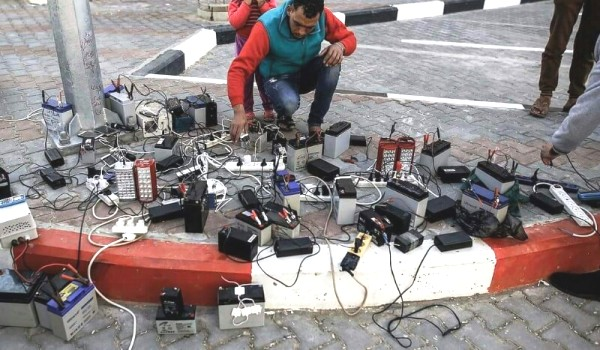 """A street corner in Gaza today. What is going on? This is a new """"telephone charger"""" business."""