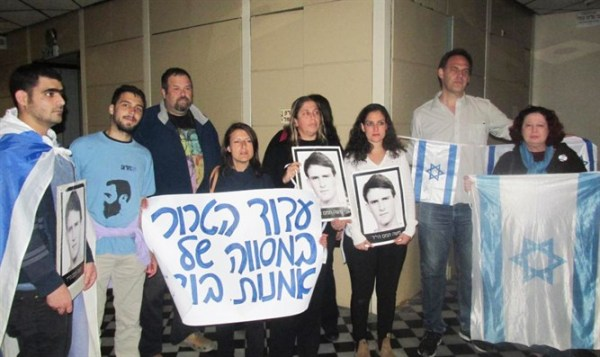 A picture of the Tamam family protesting outside the theater last year.