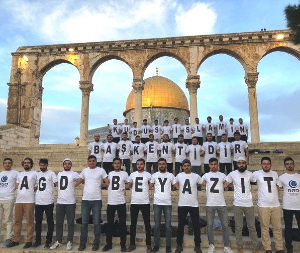 Top line: Jerusalem is Islamic; second line: it is the capital; third line: the name of the school the students belong to.