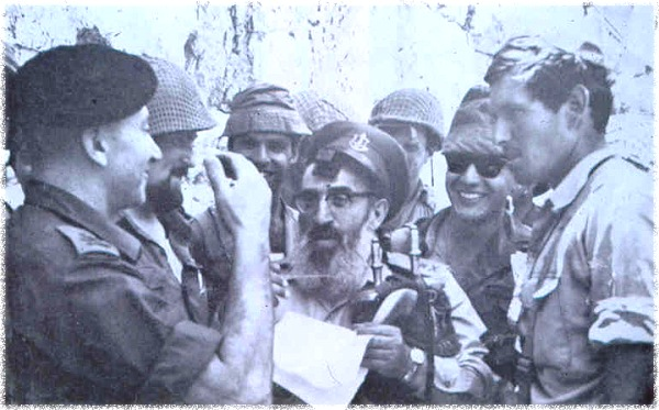 The iconic picture of Rabbi Kook at the Kotel after Israeli paratroopers captured the Old City in 1967. It has been written that Rabbi Kook was responsible for the decision of General Gur to take the Old City and the Temple Mount. Once on the Temple Mount, Kook gave an Israeli flag to paratroopers to put on the Kipat HaSela--Dome of the Rock.