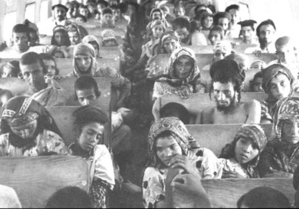 Yemenite Jews en route to Israel. Look closely at each person in the picture to get a sense of what these people went through.
