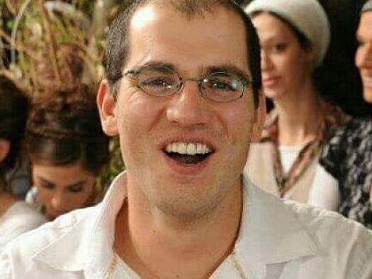 Less than 24 hours ago, Adiel Kolman was the happy father of four young children.