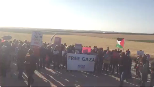 Look at these idiots. About 50 ultra-left wing Israelis are currently demonstrating a few miles away from the Gaza border. The signs speak for themselves.