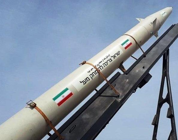 """The Iranians displayed their newest ballistic missile yesterday. Note the writing between the two Iranian flags. It reads """"Israel must be erased."""""""