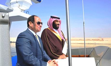 Egyptian President Abdel-Fattah el-Sissi, left, and Saudi Crown Prince Mohammed bin Salman tour the Suez canal near Ismailia, 120 kilometers (75 miles) east of Cairo (picture: Mena).
