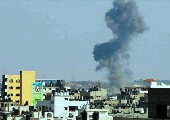 The smoke is rising from an IDF strike on Gaza today--this picture was taken in Gaza looking toward Israel.