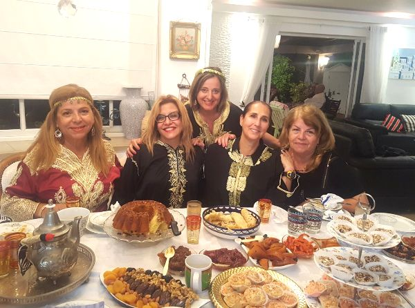 Our wonderful hostess Yael (far left) and the other women (including your humble servant's wife) sitting around the table.