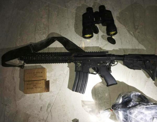 An assault rifle, ammunition, and binoculars: standard issue for a terrorist.